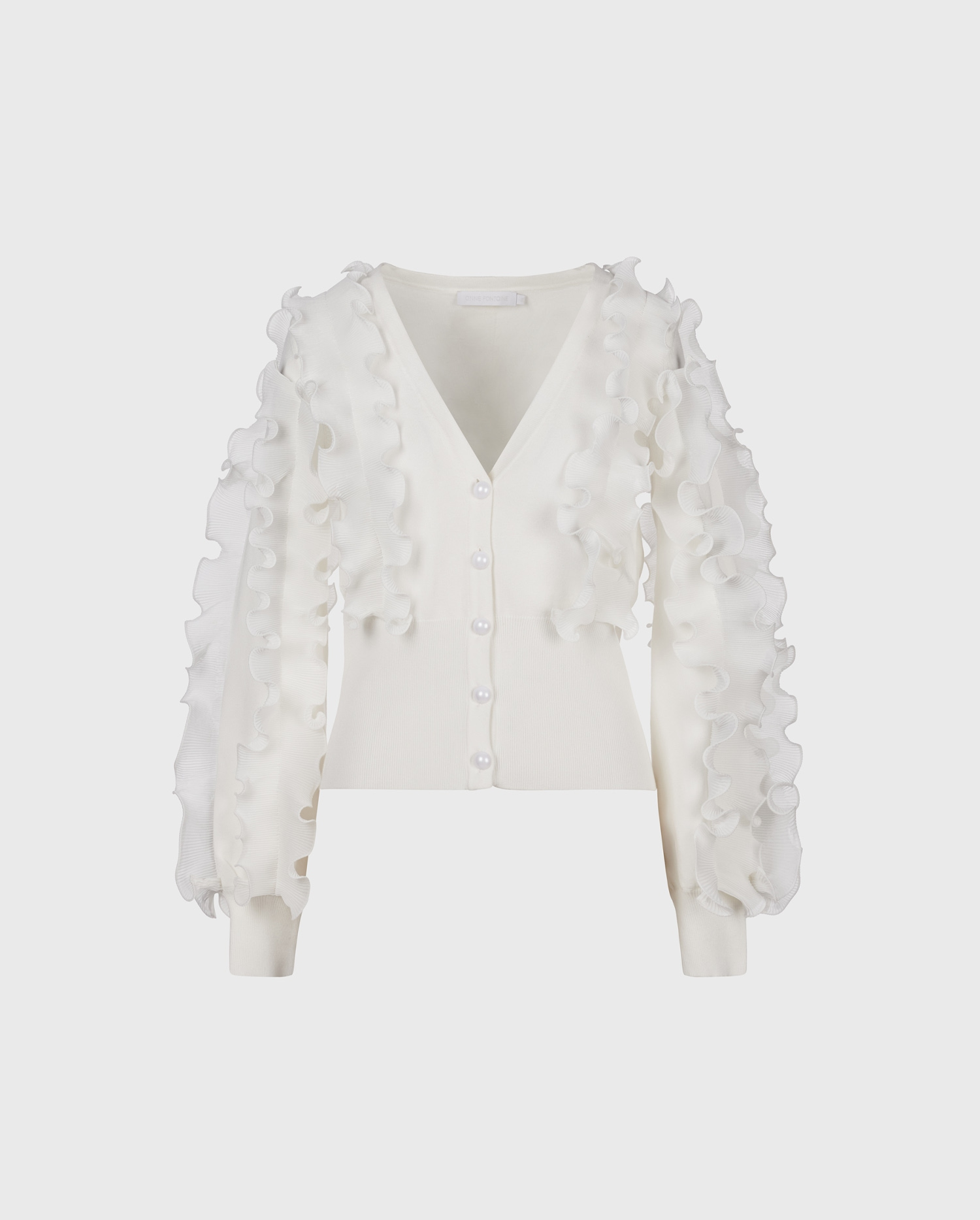 Ciline is the perfectly Parisian cardigan sweater featuring statement ruffles throughout.