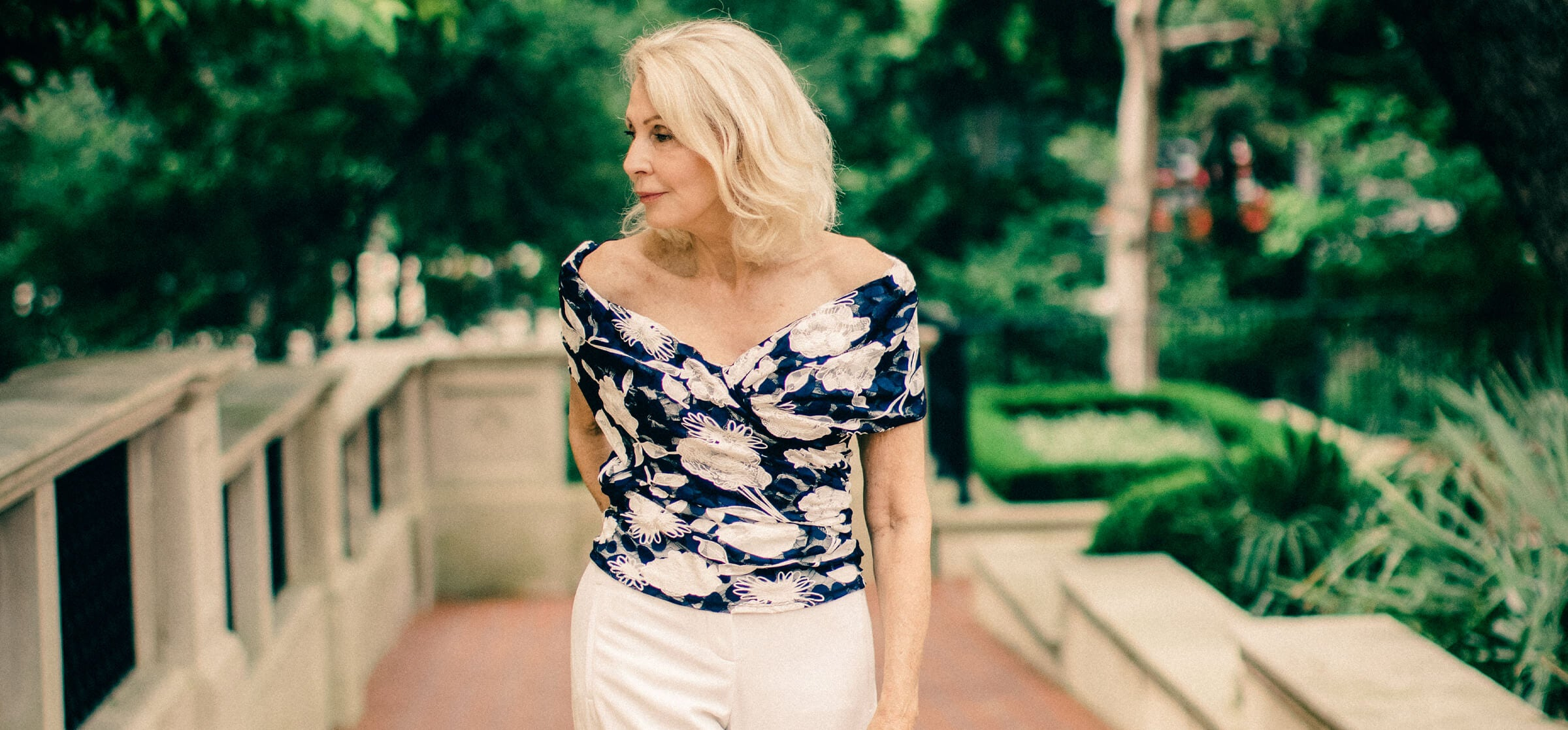 Sonia from @stylebeyondage wears the CHAMA floral top