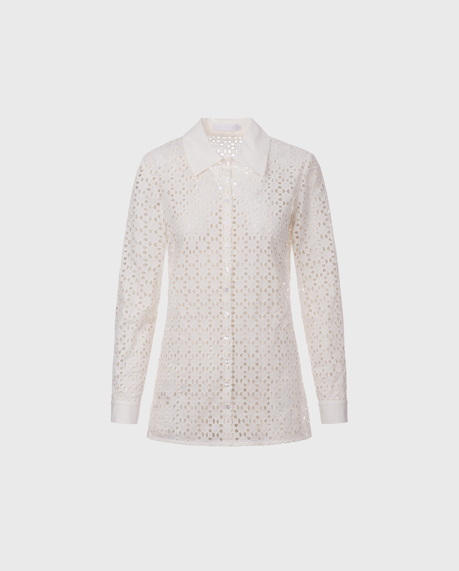 The CEFALU white eyelet embroidered shirt with poplin details is the perfect white shirt to add to your summer wardrobe.