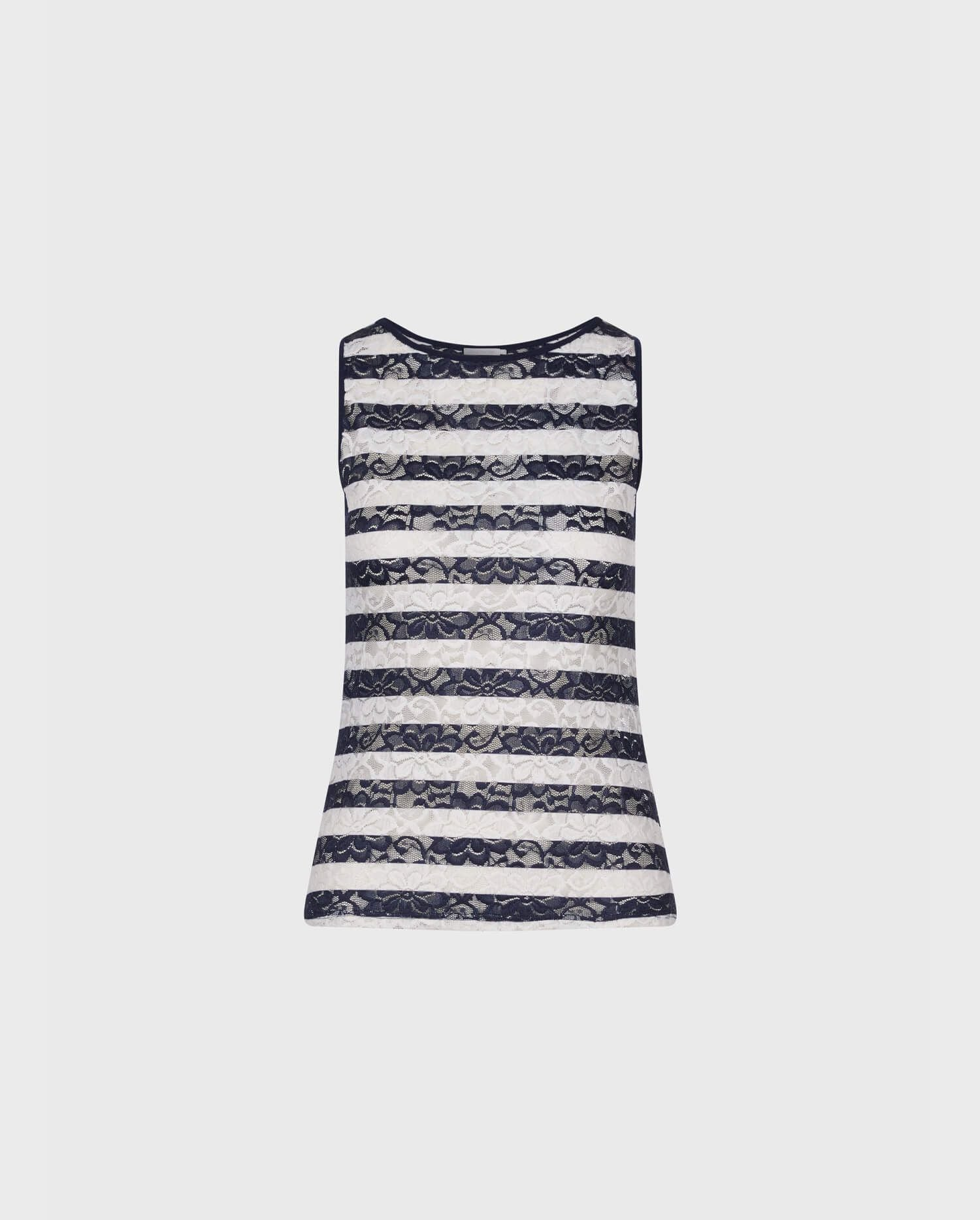 Add the blue and white stripe mariner inspired CHARLENA top for the perfect look of Parisian chic.