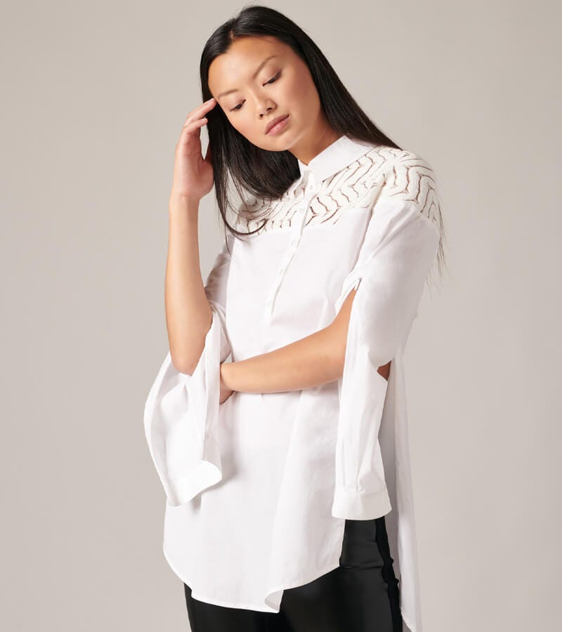 Discover the beauty and elegance of the Barabara white shirt featuring an artisinal touch.