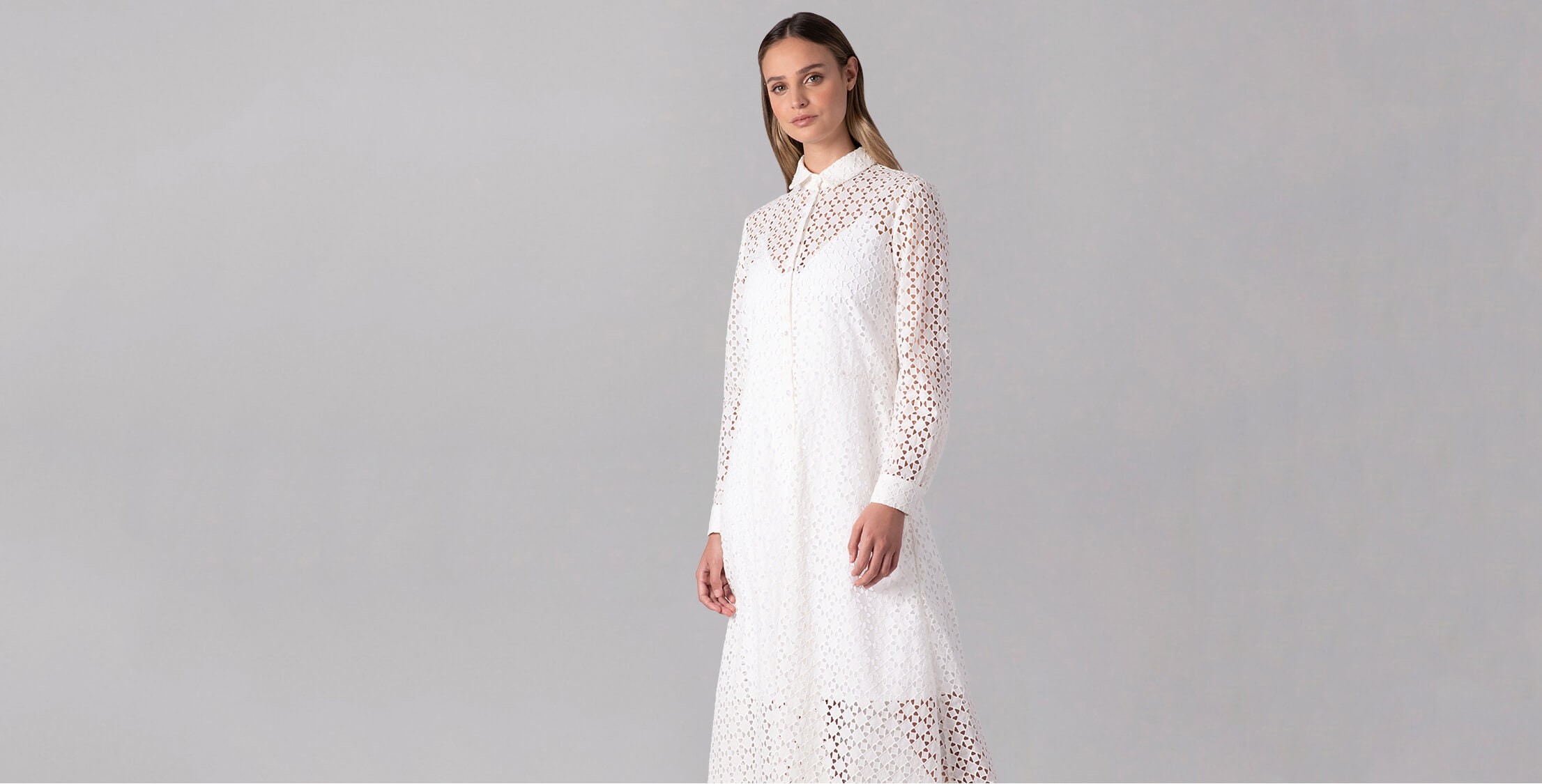 The CASCAIS broderie anglaise white maxi lace dress will make sure you arrive in style