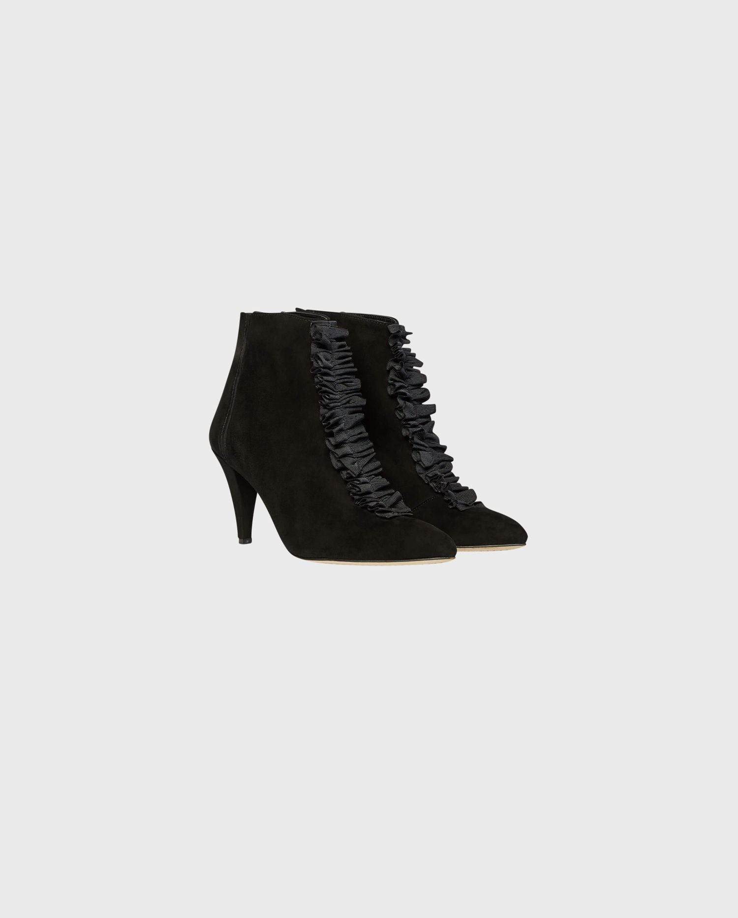 Comfortable and chic is on the table this season with the GWEN suede ruffle bootie