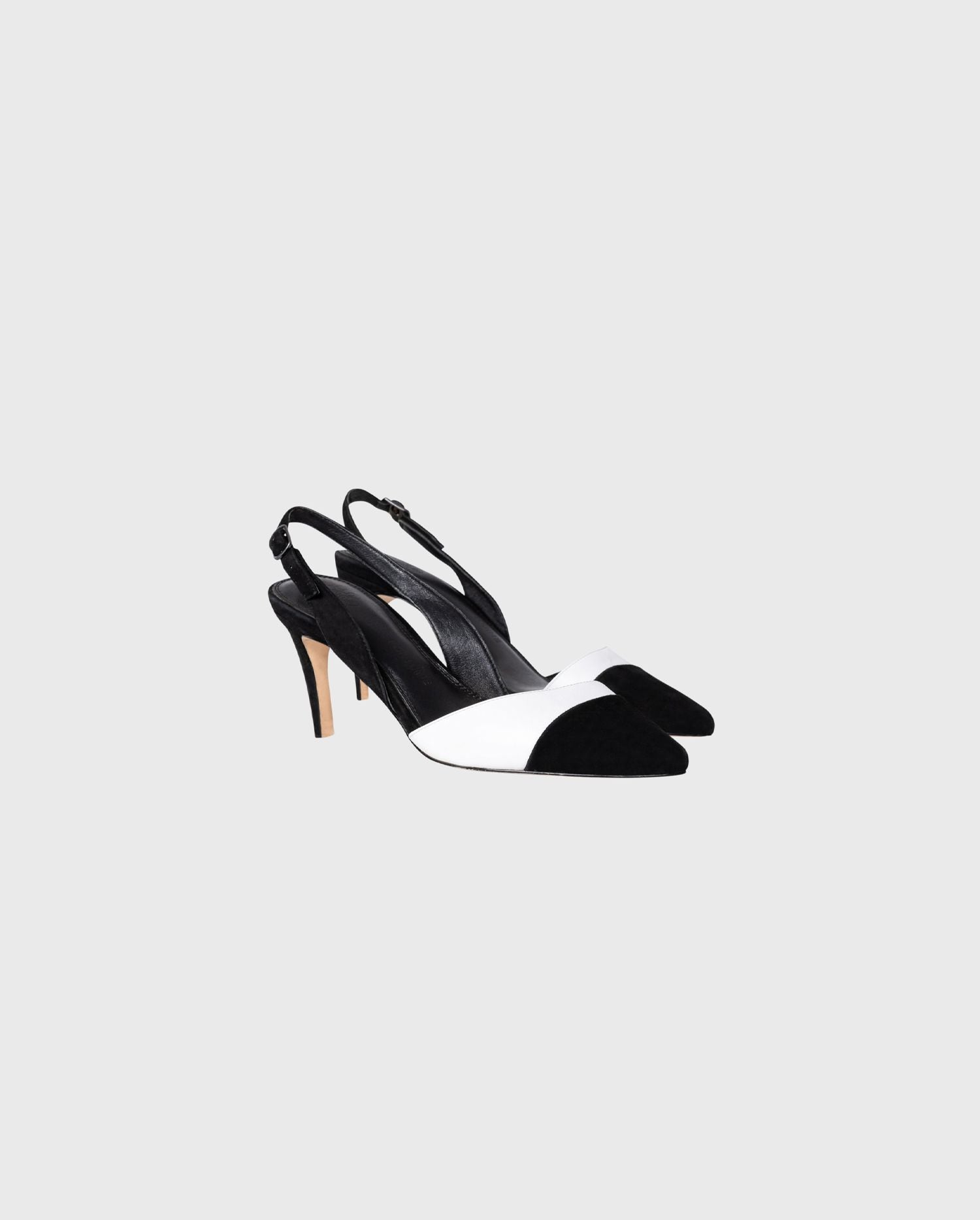 The black and white slingback JAKIE heel will guide you through the seasons with a look of pure chic