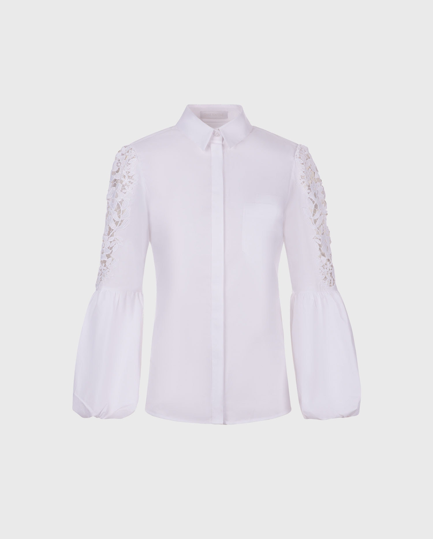 The LAORA white embroidered sleeve shirt is the perfect silhouette to add to your wardrobe.