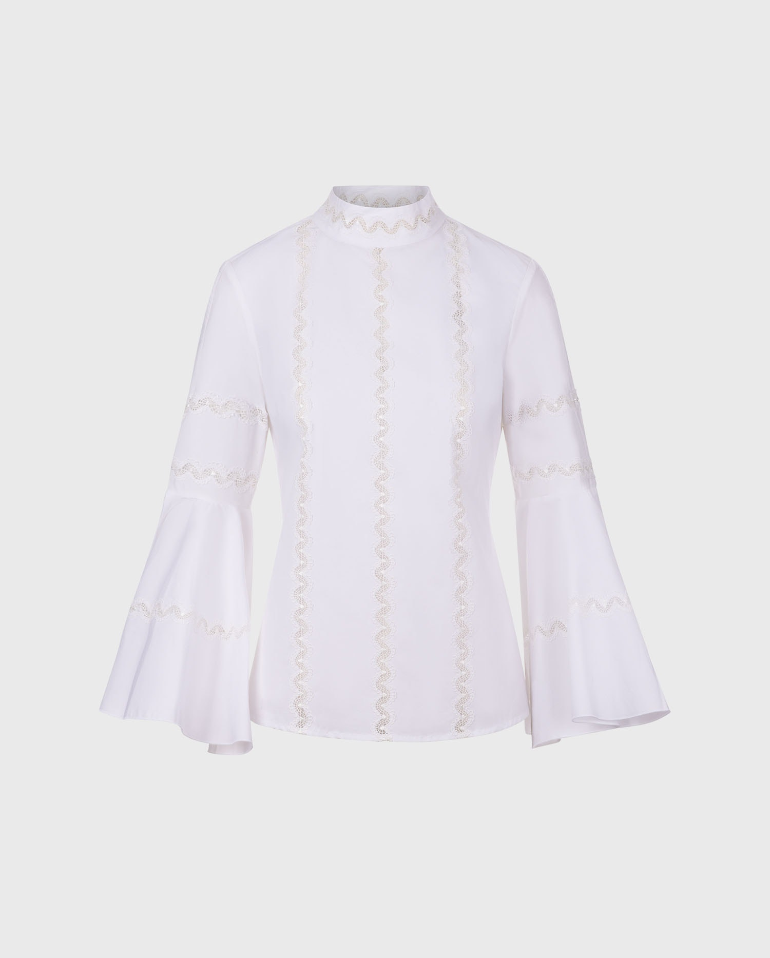 The the LEONTINE whire bell sleeve white shirt is the perfect style to add to your Parisian chic wardrobe