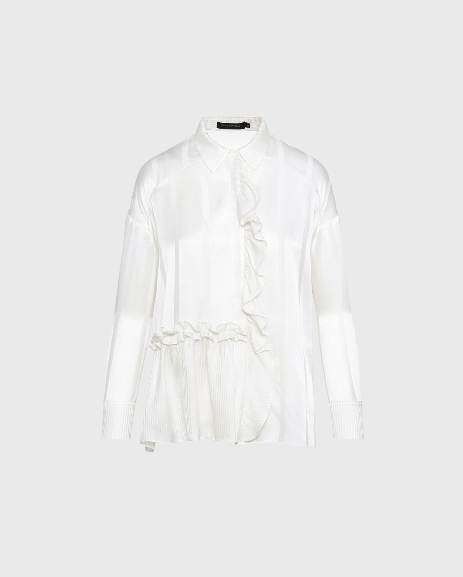 Slip to into the cream color silk button down shirt, LOUEVA to add a dose of chic to your wardrobe.